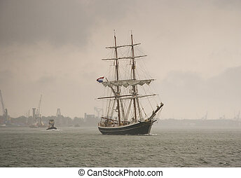 Brig in heavy rain - A brig in heavy rain sailing on the...