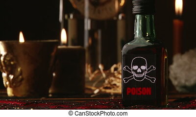 Poison in bottle - Poison, candles and old clock in...