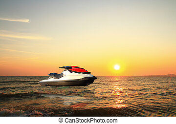jetski above the water at sunset