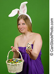 Young woman with Easter eggs