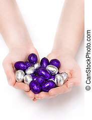 Puple and silver Easter eggs in hands - Pair of hands...