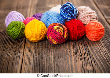 Knitting yarn on rustic wooden background