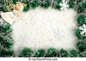 Christmas frame from a garland, snowflakes and angel