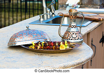 Shish Kebabs on outside kitchen concrete counter top...