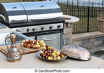 Skewers and Outdoor Kitchen - Meat skewers with vegetables...