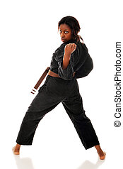 Back Handed Karate Fist - A woman looking over her shoulder...