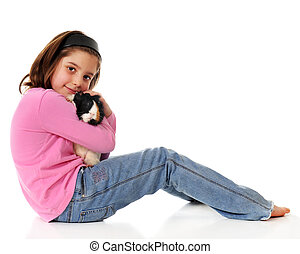Guinea Pig Lover - Portrait of an elementary girl hugging...