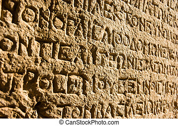 Greek alphabet - ancient Greek writing chiselled on stone