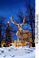 Christmas deer in small town - Christmas deer small town...