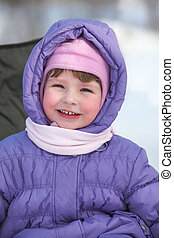 Smiling Caucasian girl in hood with scarf on neck