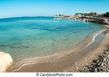 Empty waterfront with sandy beach in Cyprus, Mediterranean sea