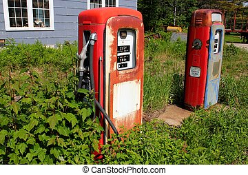 gas pumps - pair of vintage gas pumps