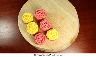 Decorating Cupcakes - Decorating cupcakes with a pink rose...