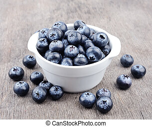 Blueberries on wooden table.