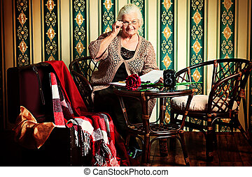 fairy tale - Portrait of a smiling senior woman reading a...