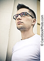Flashes in glasses - Young man in white T-shirt wearing...