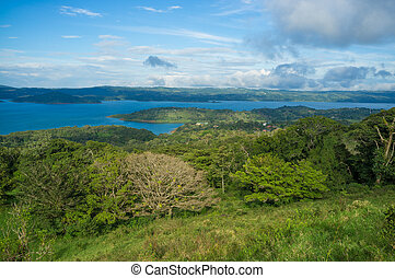Arenal landscape - Volcanic lagoon Arenal surrounded by lush...