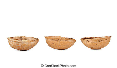 Three walnut shells - Walnut shells on white background