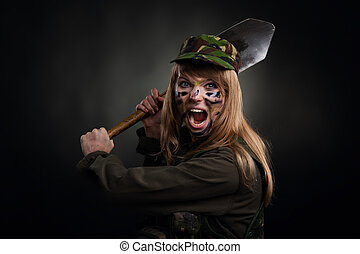military girl - army girl attack shovel, soldier woman in a...