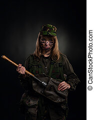 military girl - army girl hold shovel, soldier woman in a...