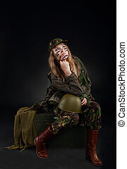 military girl - army girl, soldier woman sitting wear...