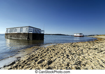 House Boats in Poole Harbour - House boat on the beach at...