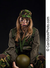 military girl - army girl, soldier woman sitting hold helmet...