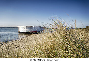 Old House Boat on the Beach - Old house boat on the beach at...