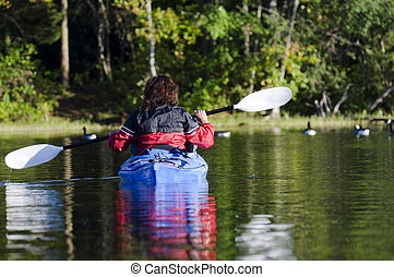 Kayaker on the Lake - Selective focus on the woman in her...