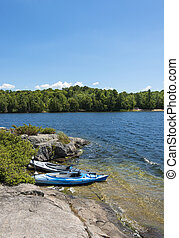 Kayaks on a Northern Lake