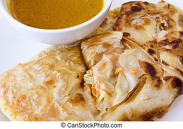 Indian Roti Prata with Curry Sauce Closeup - Indian Roti...