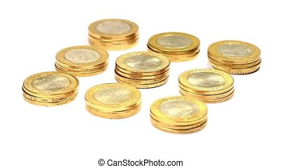 Rotating golden coin stacks. Loop - Stacks of golden coins...