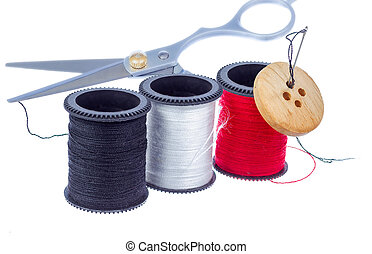 Tailor kit. - Set of thread spools, needle, button and...