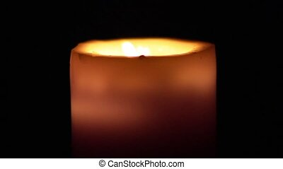 Candle Wax - Burning wax candle in the dark