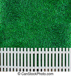 Bush wall with white fence for background