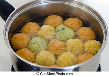 Matzah balls - Passover Food - Matzah balls in a pot of soup...