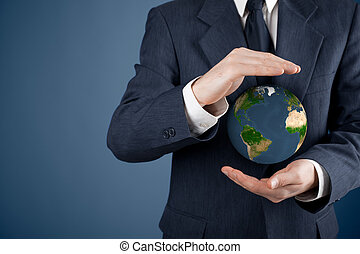 Protect planet Earth - Business man protecting the Earth...
