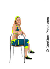 Young fitness instructor sitting on chair