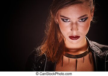 Young woman against dark background
