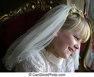 Girl in holy communion dress - A young girl wearing her...