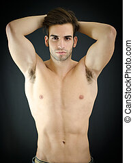 Sexy young man, shirtless, with arms up behind his head -...