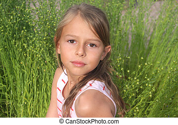 Portrait of young girl - A 10 year old girl looking at the...