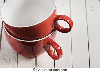 Coffee Cups - Two red coffee cups on wooden background