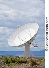 Radio Telescope - A large radio telescope dish in the remote...