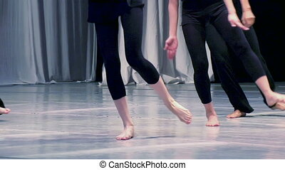 Contemporary choreography - Men and women dressed in black...