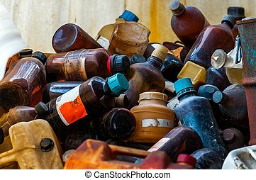 Toxic waste dump with a lot of bottles closeup