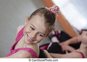 Ballet girl with friends during ballet lesson - Young girl...