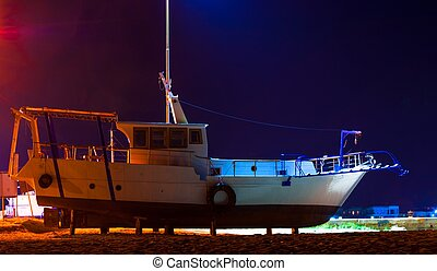 Fishing boat at night