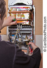 repair of household water heater - repair of the gas water...