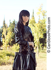 Photo of beautiful woman is in modern style, cool lady